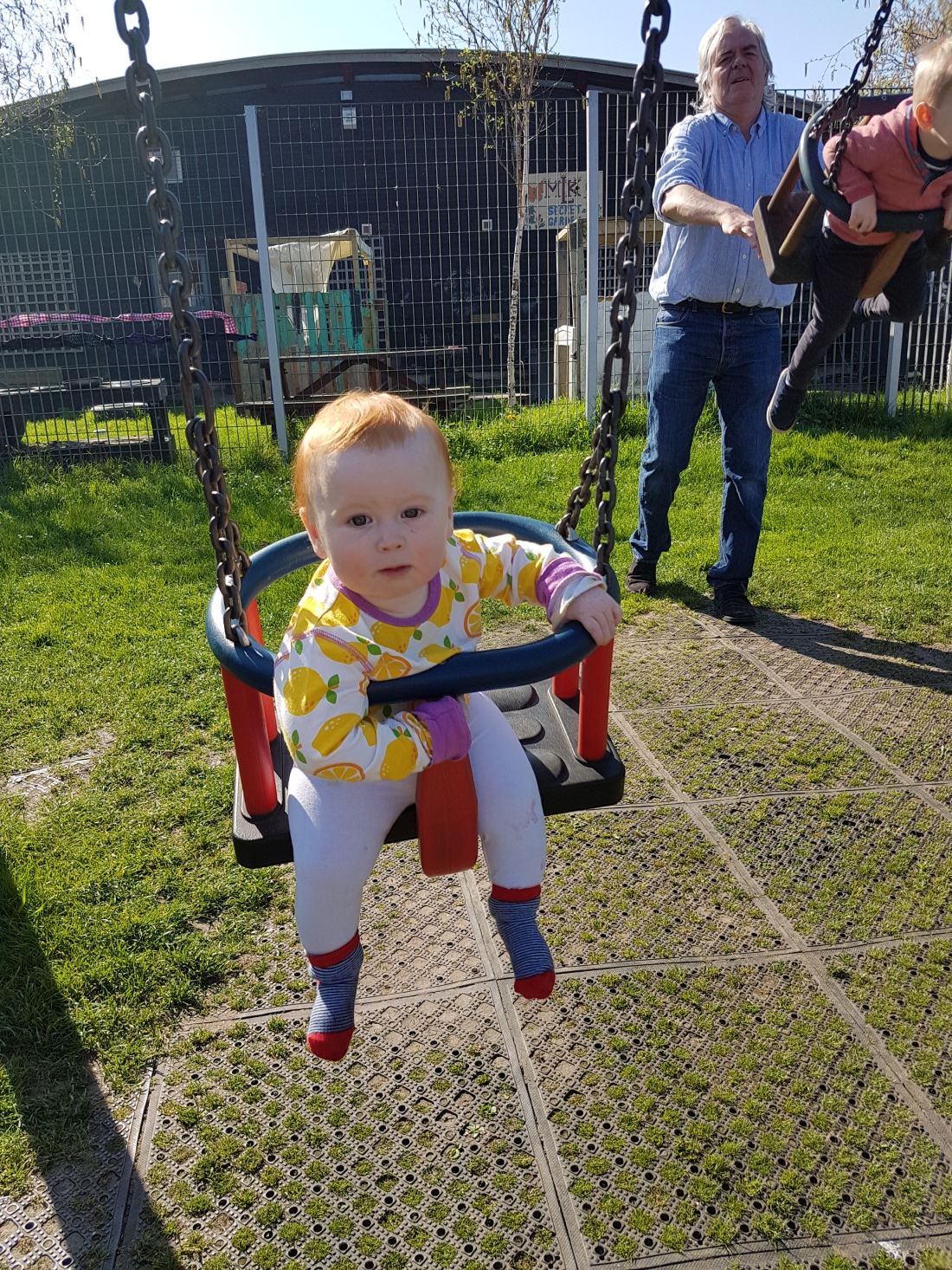 10 month old baby on swings in Paradise Park